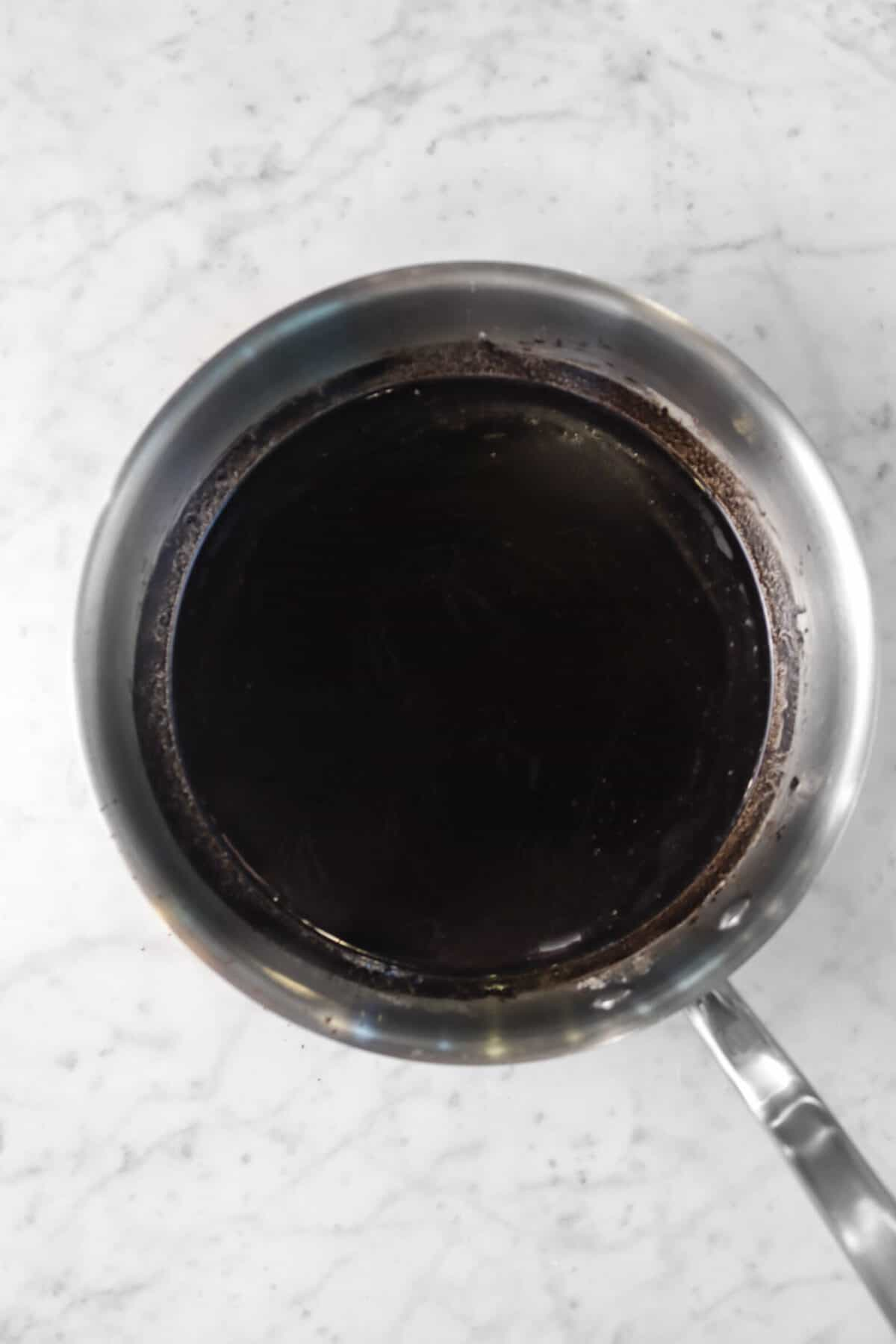 butter and cocoa powder mixed together in a large sauce pan