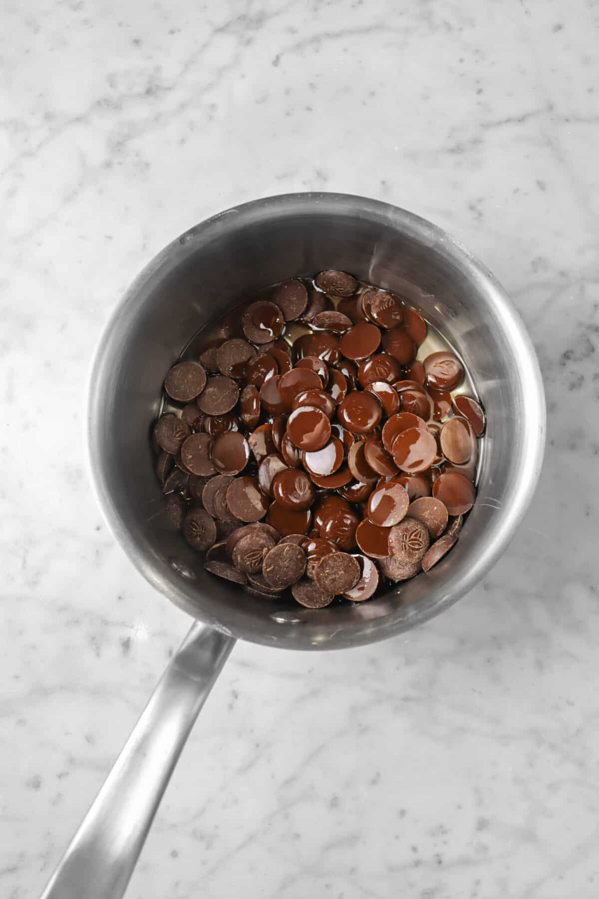 chocolate chips and oil in a small pot