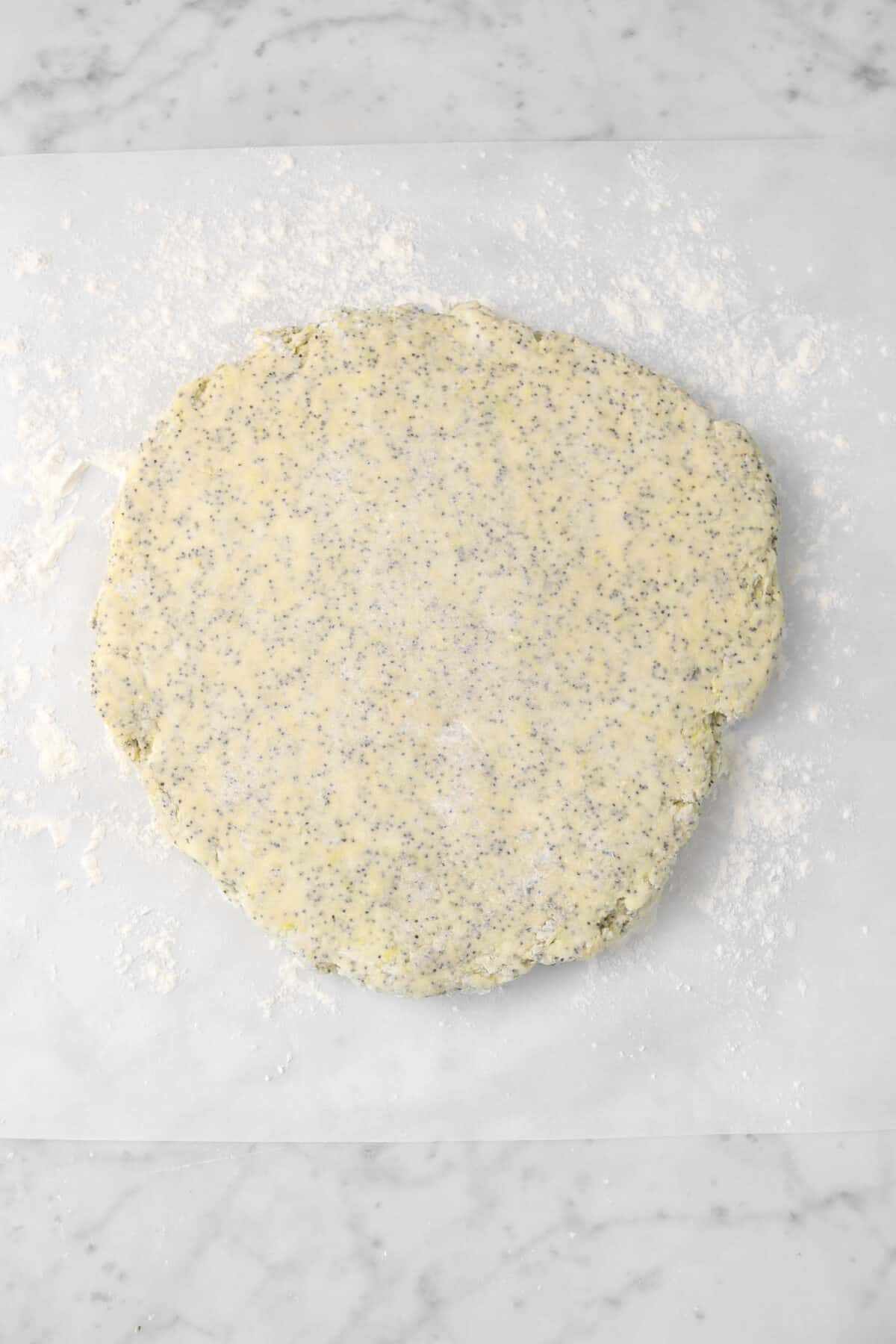 scone dough rolled out on parchment