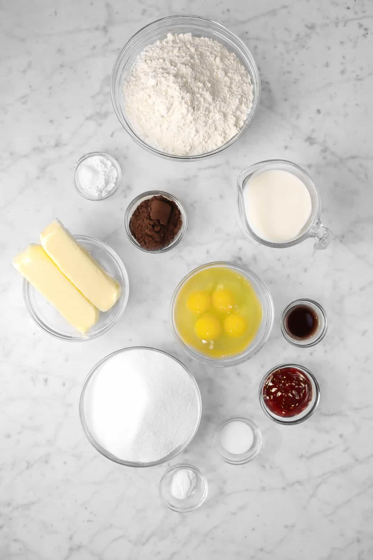 ingredients for red velvet cake on a marble counter