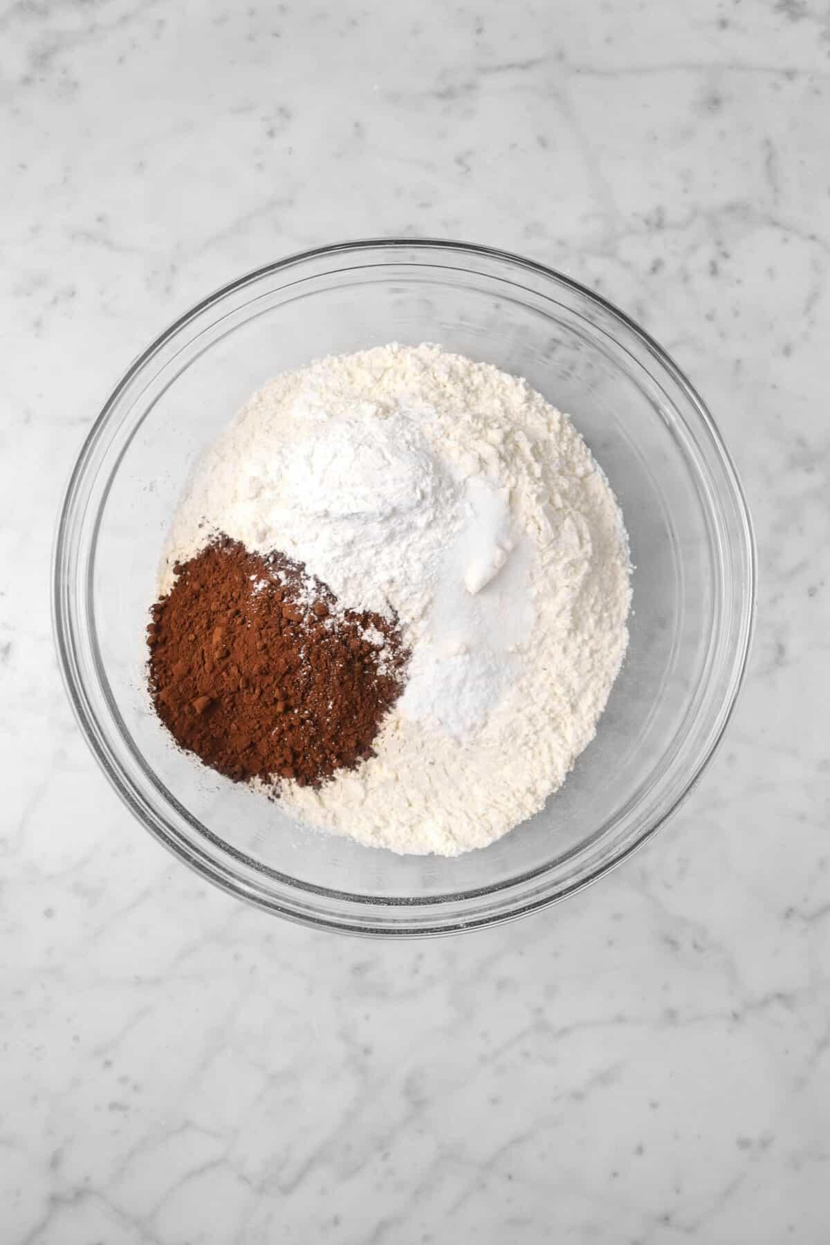 flour, cocoa powder, baking soda, and baking powder in a glass bowl