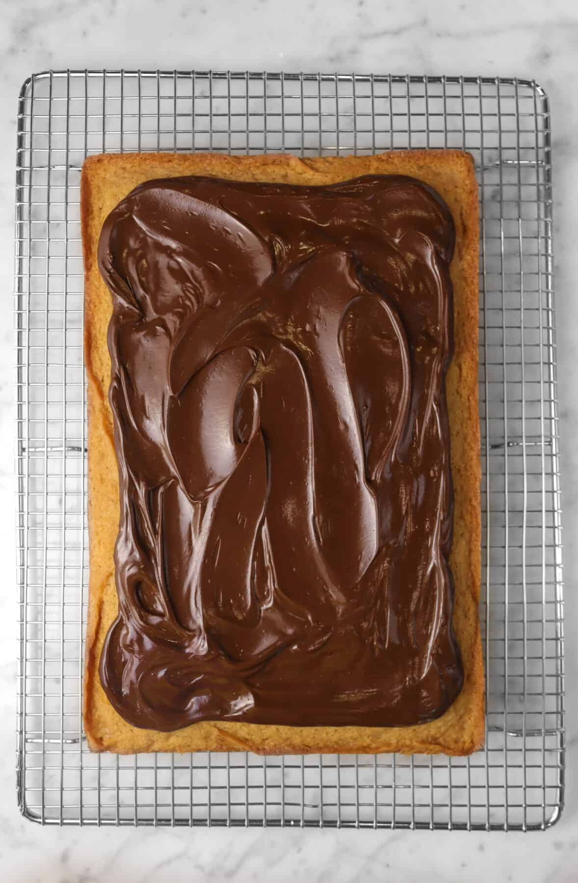 chocolate ganache spread onto cinnamon cake