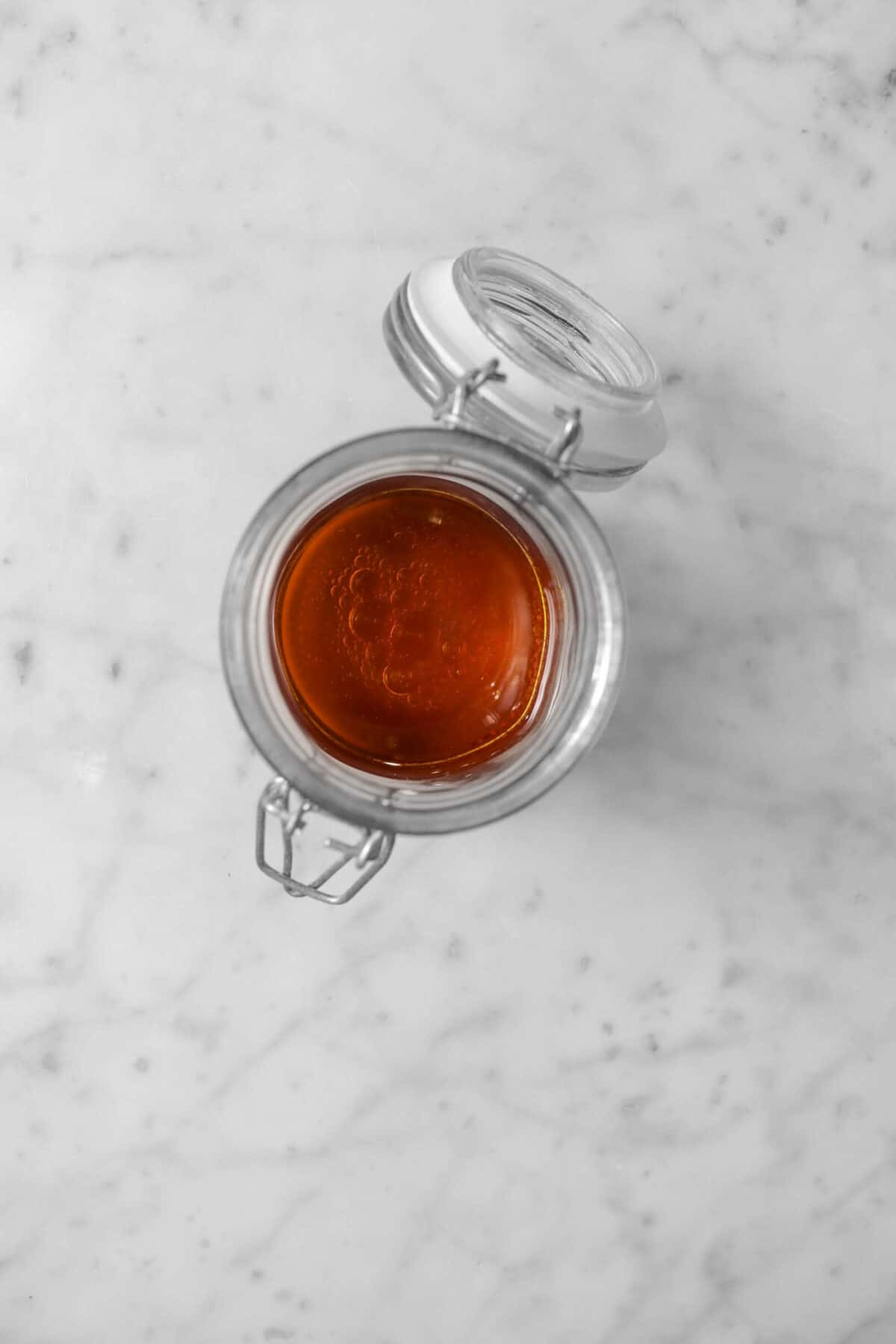 red wine vinegar and olive oil in a jar