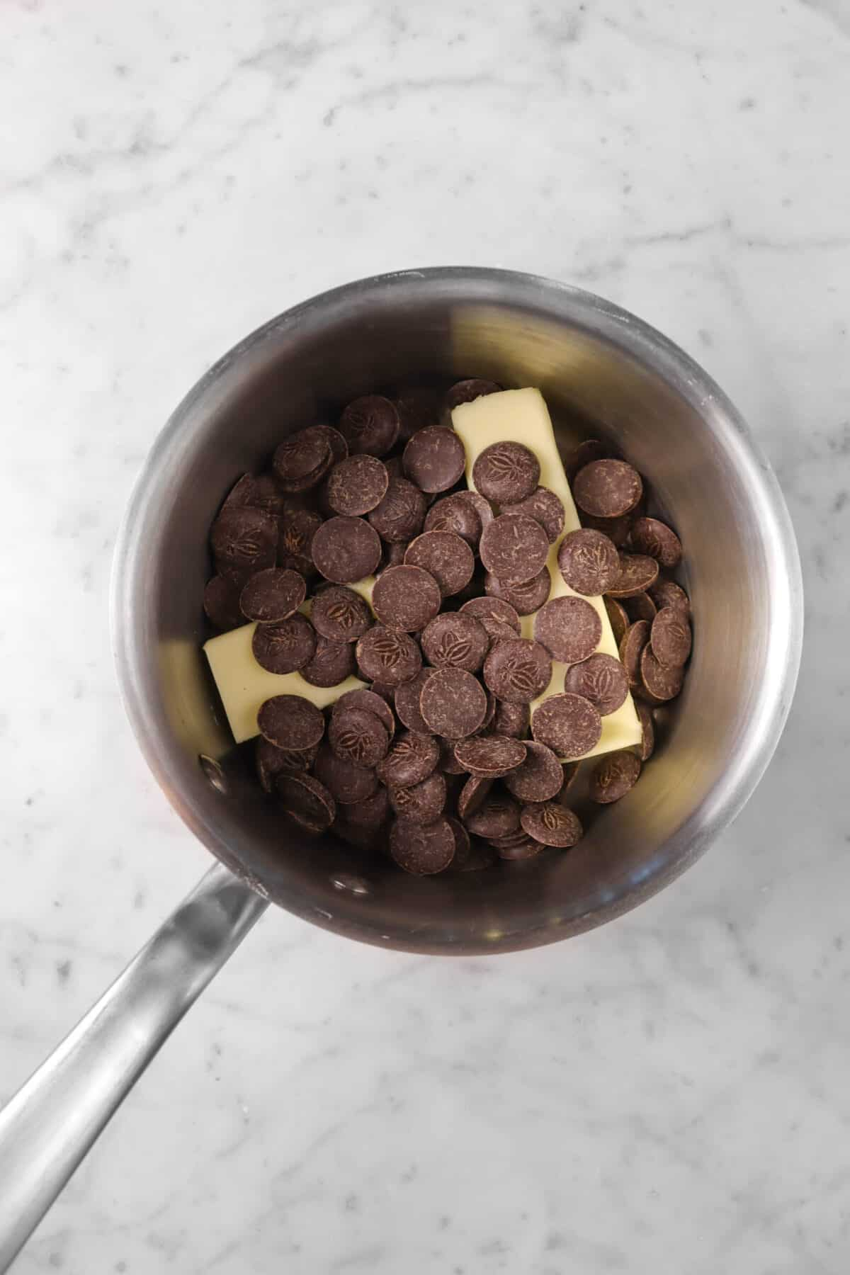 butter and chocolate chips in a small pot