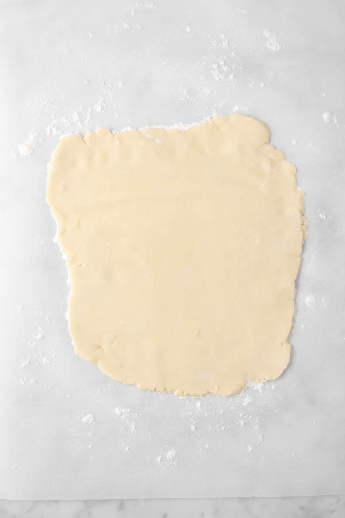pastry dough rolled out on a piece of parchment