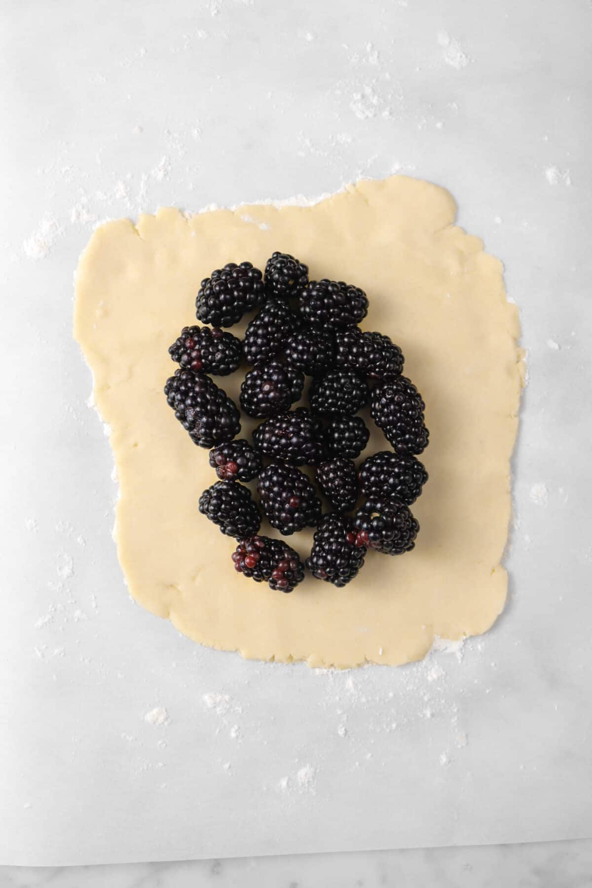 blackberries added onto rolled out pastry dough