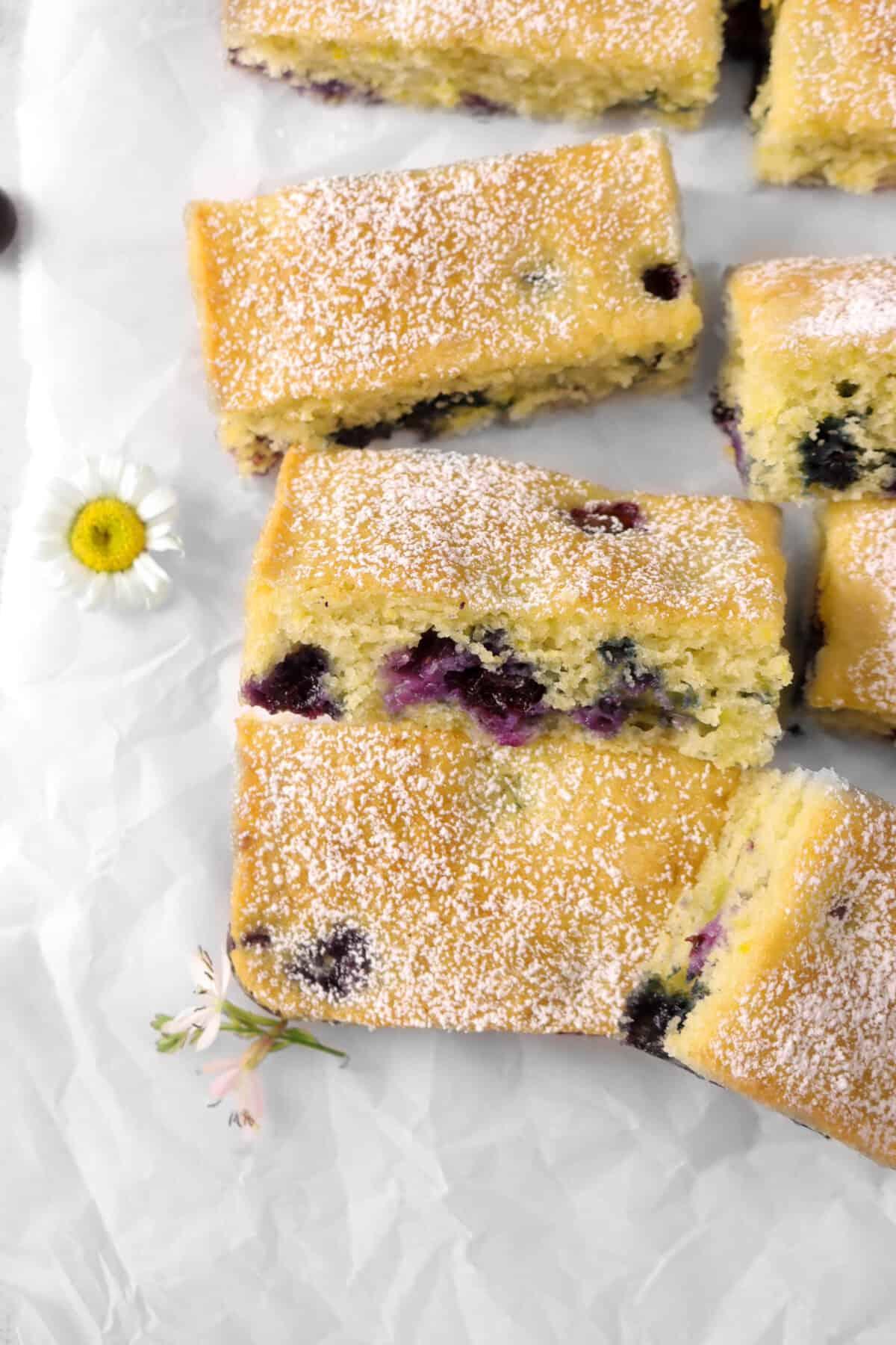 Lemon Blueberry Snack Cake slices with fresh flowers