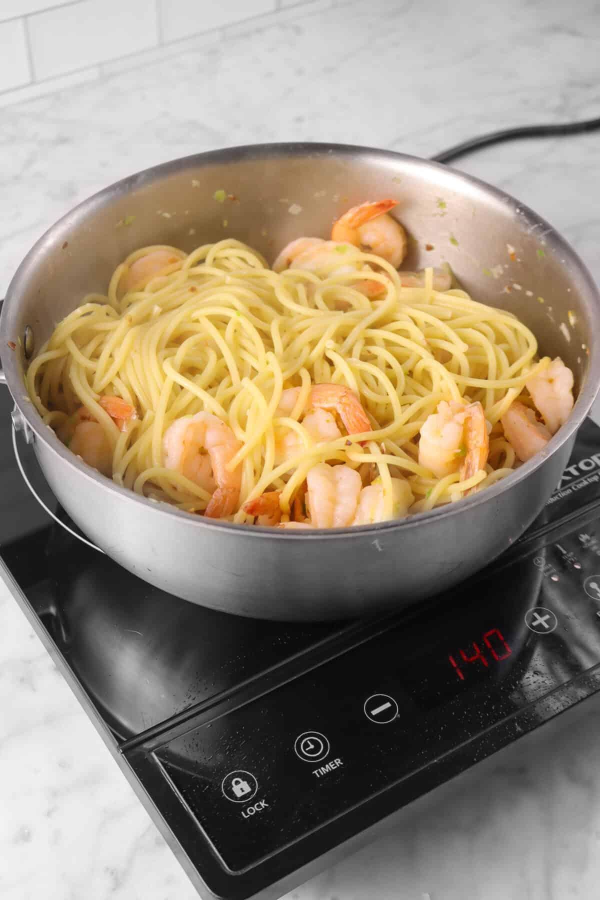 pasta stirred into shrimp scampi