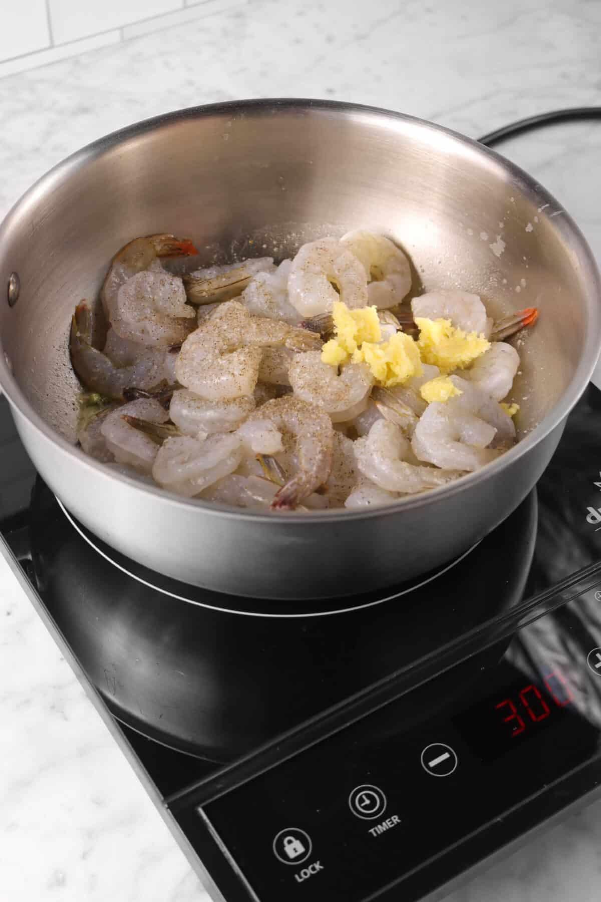 garlic, salt, and pepper added to butter mixture