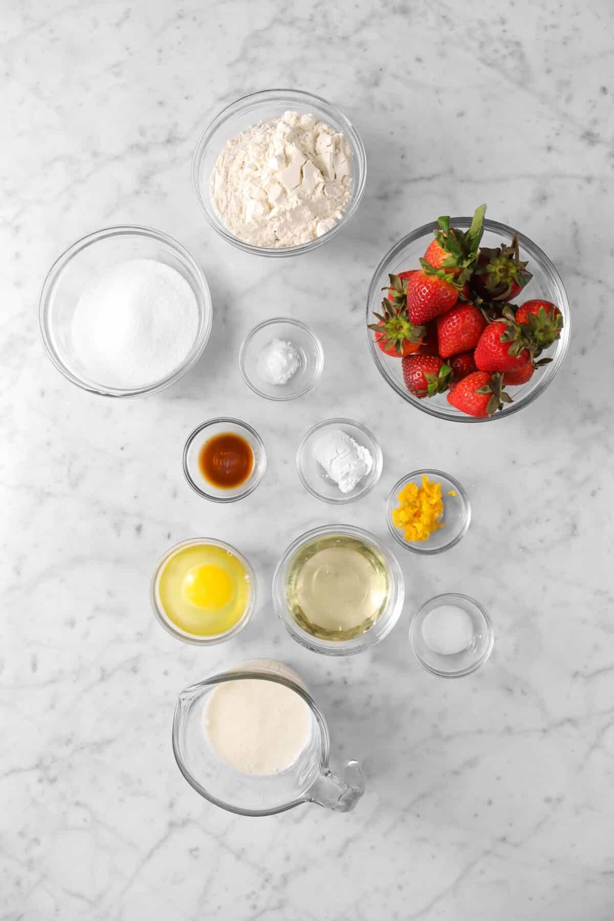 flour, sugar, baking soda, baking powder, orange zest, oil, egg, salt, buttermilk, and strawberries in bowls