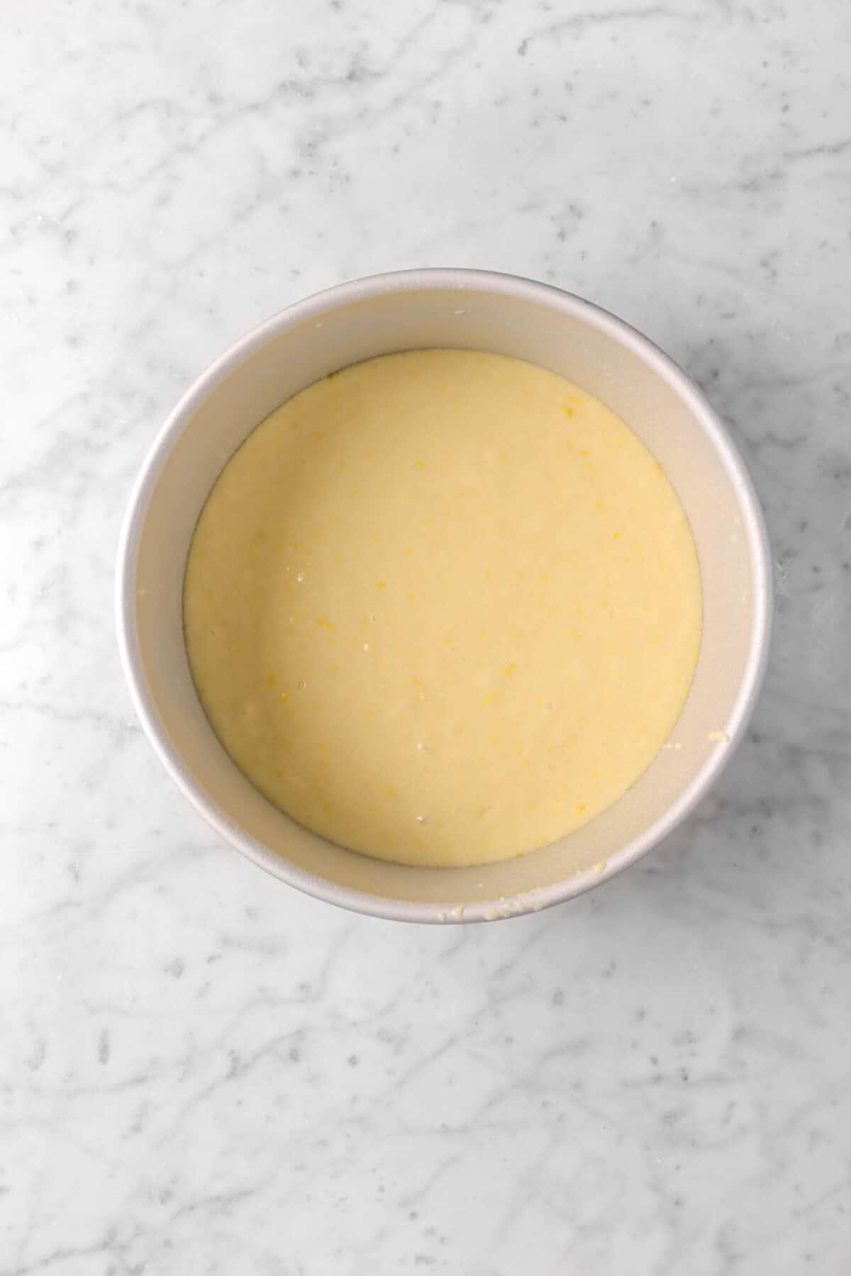 cake batter in a circle cake pan