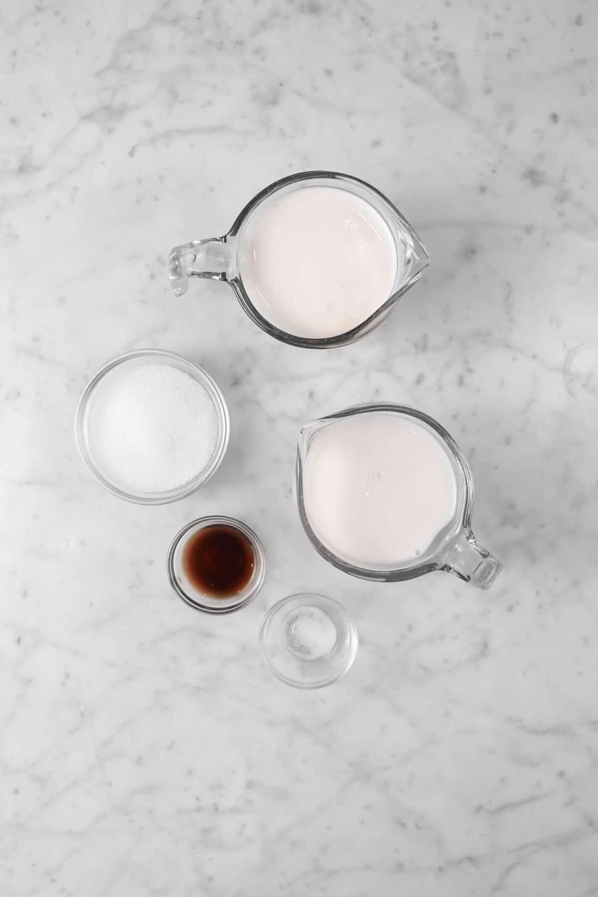 heavy cream, half and half, sugar, vanilla, and salt on marble counter