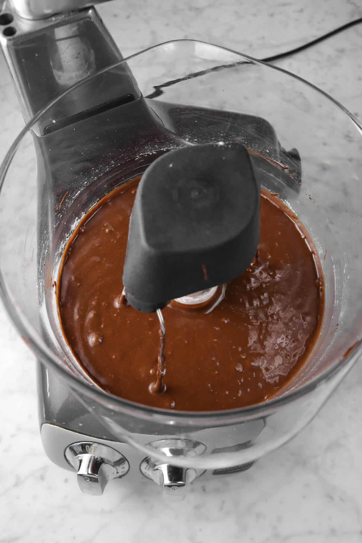 flour mixed into chocolate brownie batter