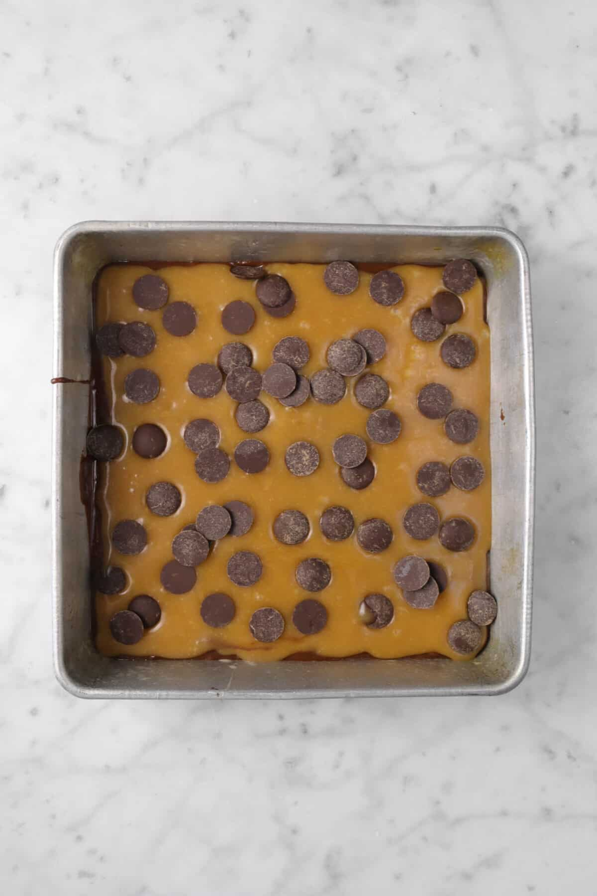 Chocolate chips added over caramel