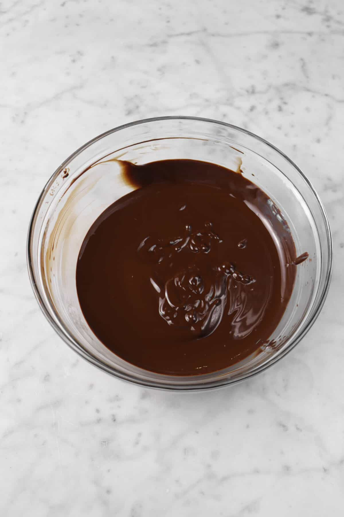 chocolate melted in a glass bowl
