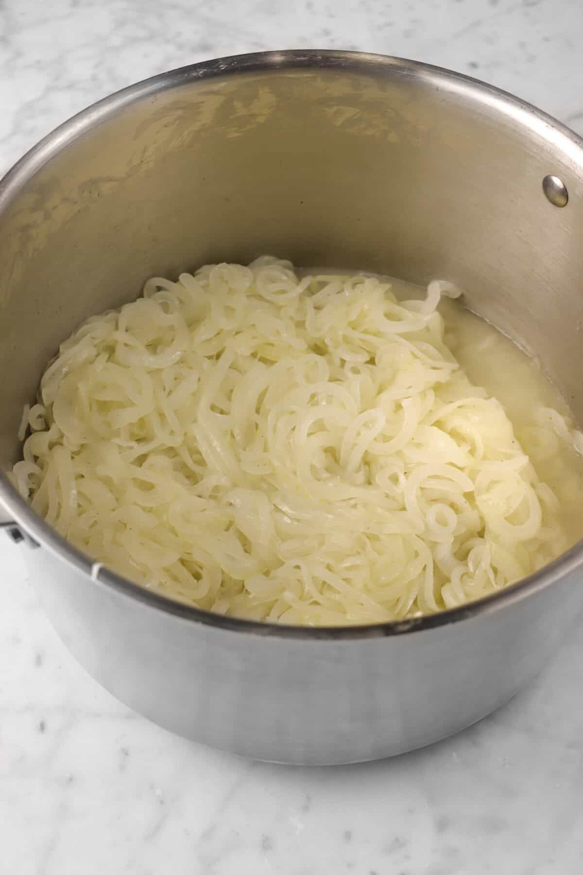 onions cooked down in a large pot with white wine added