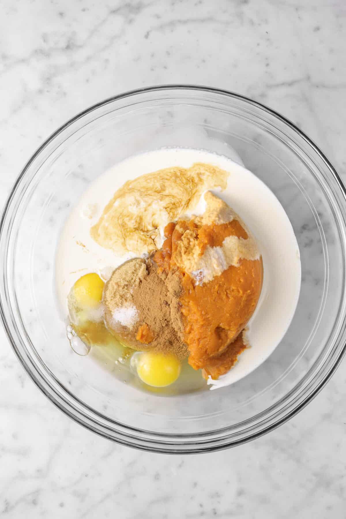pumpkin, eggs, spice, heavy cream, brown sugar, and vanilla in a glass bowl