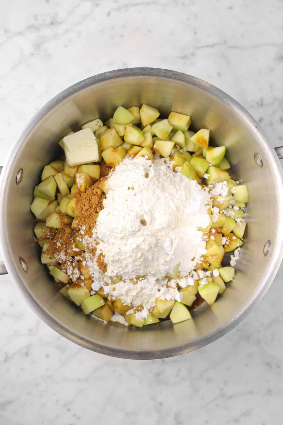 chopped apples, flour, vanilla, cinnamon, powdered sugar, and butter in a pot