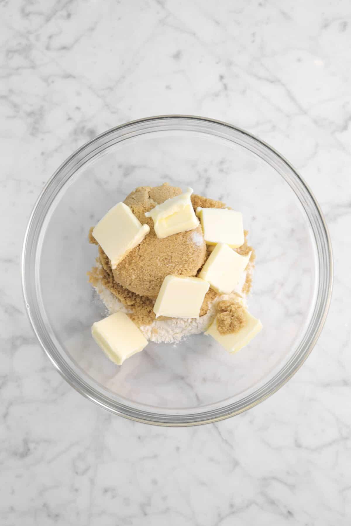 flour, brown sugar, salt, and butter in a glass bowl
