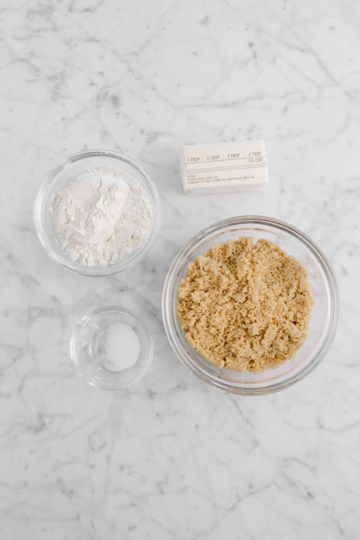 flour, butter, salt, and brown sugar in glass bowls