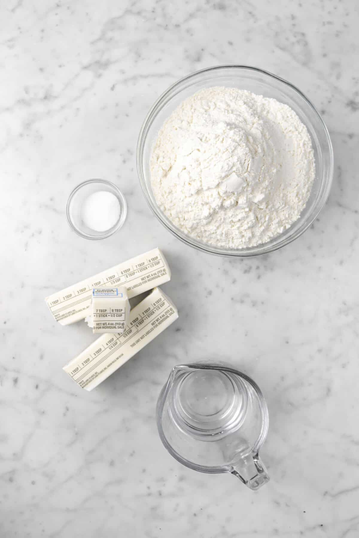 flour, salt, butter, and water on marble counter