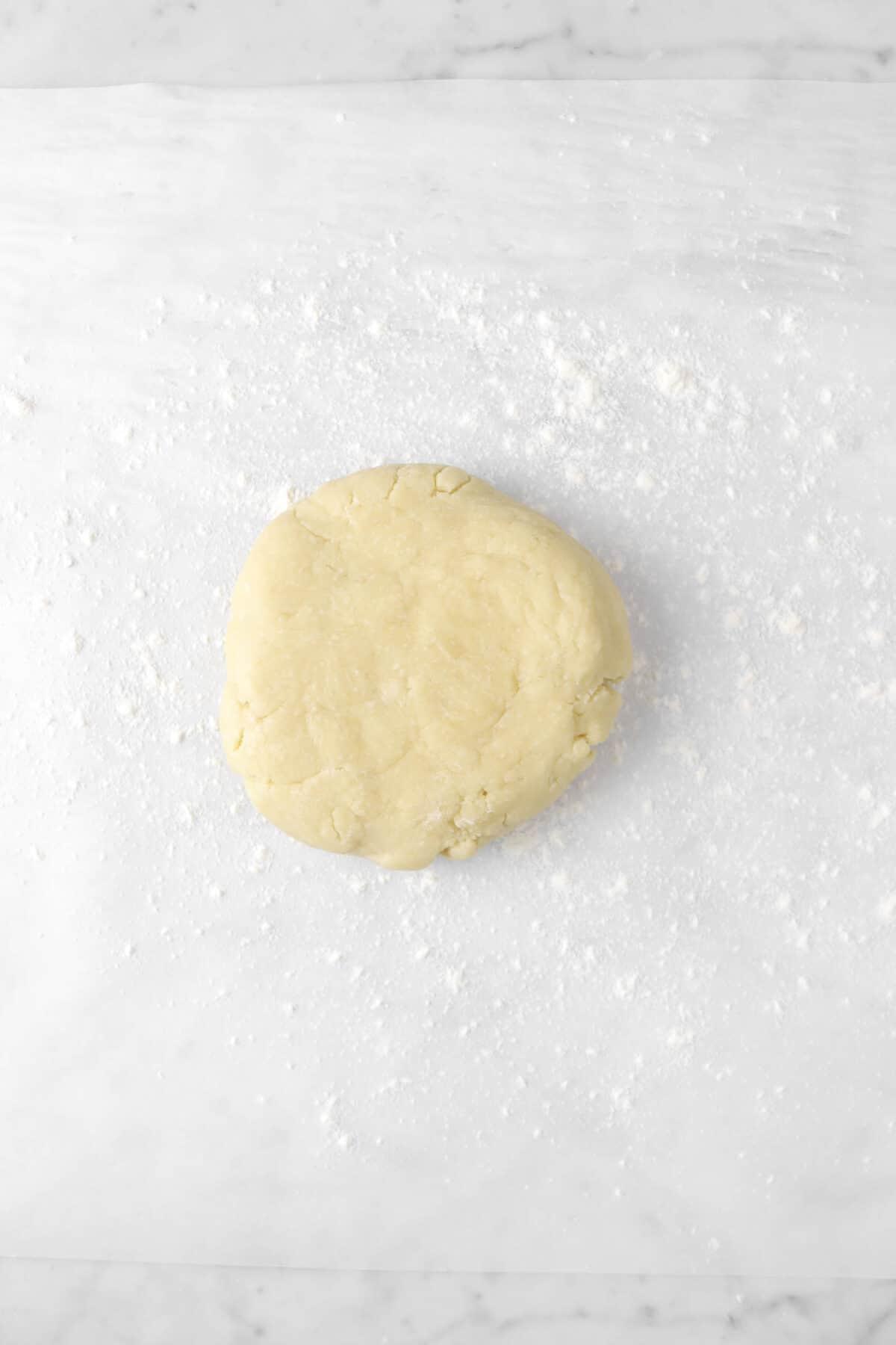pie dough on lightly floured parchment paper