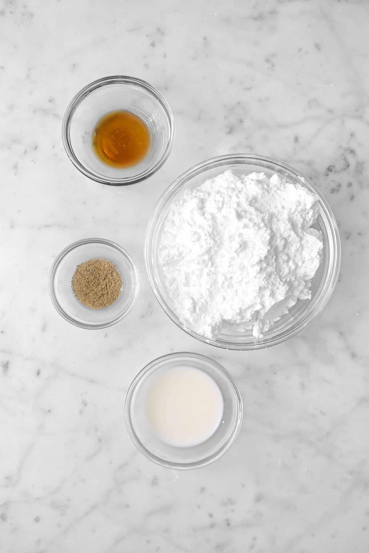 powdered sugar, vanilla, ground cardamom, and milk in glass bowls