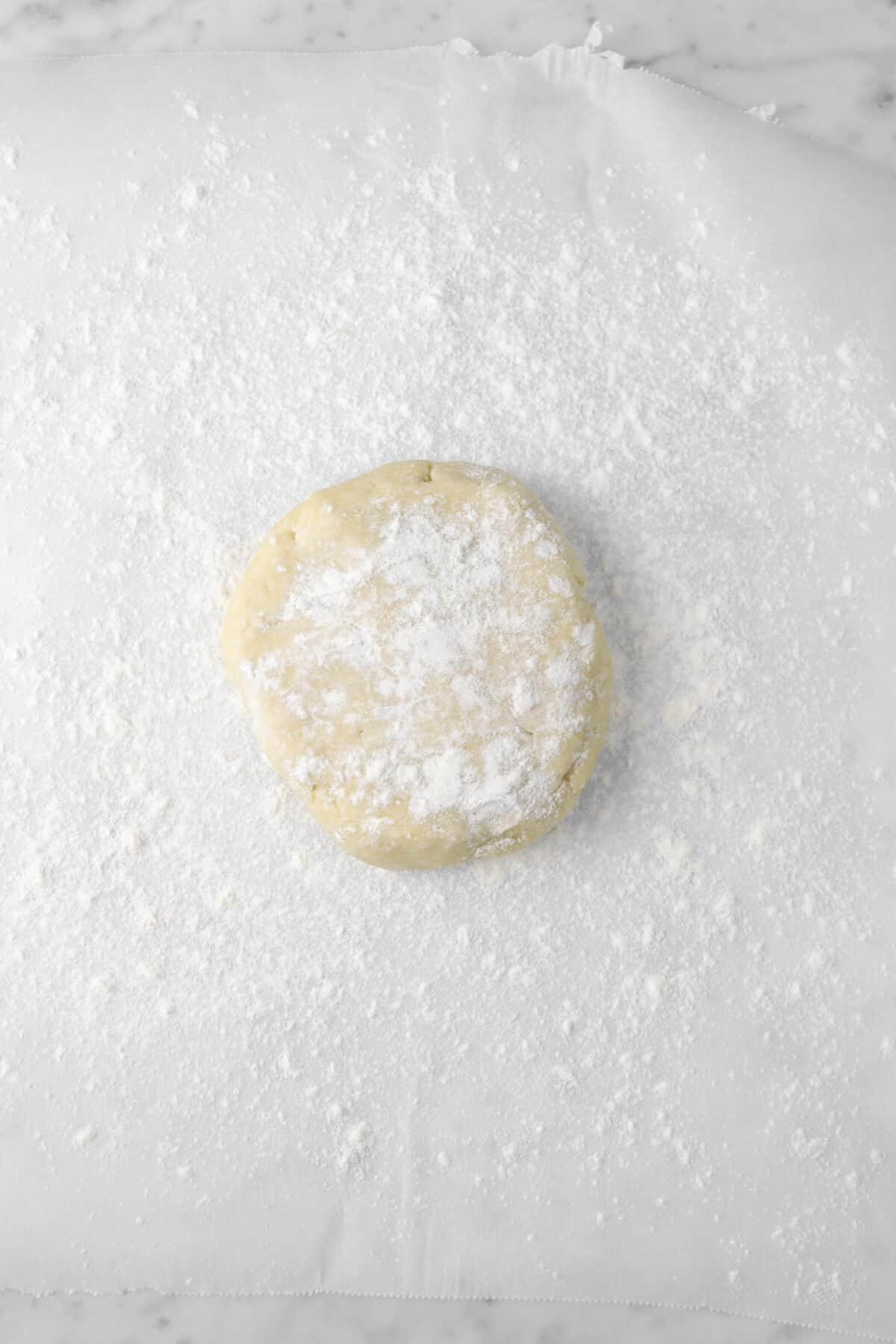 pie dough on a lightly floured piece of parchment paper