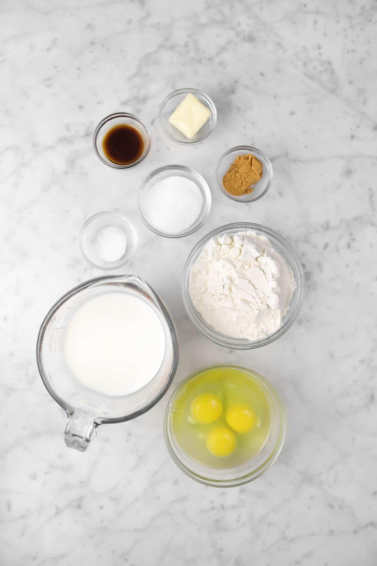 eggs, flour, milk, salt, sugar, cinnamon, vanilla, and butter in bowls