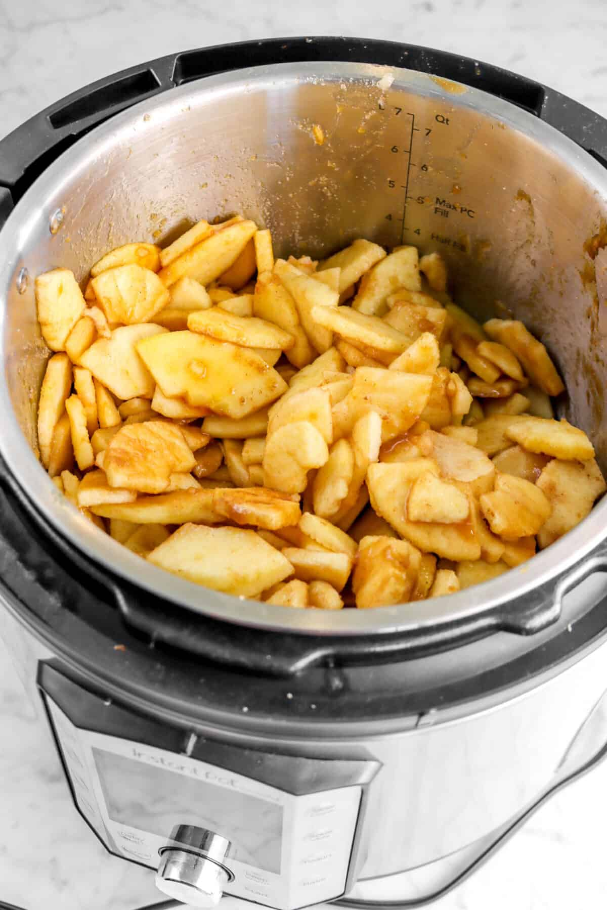 apples tossed with other ingredients in an instant pot