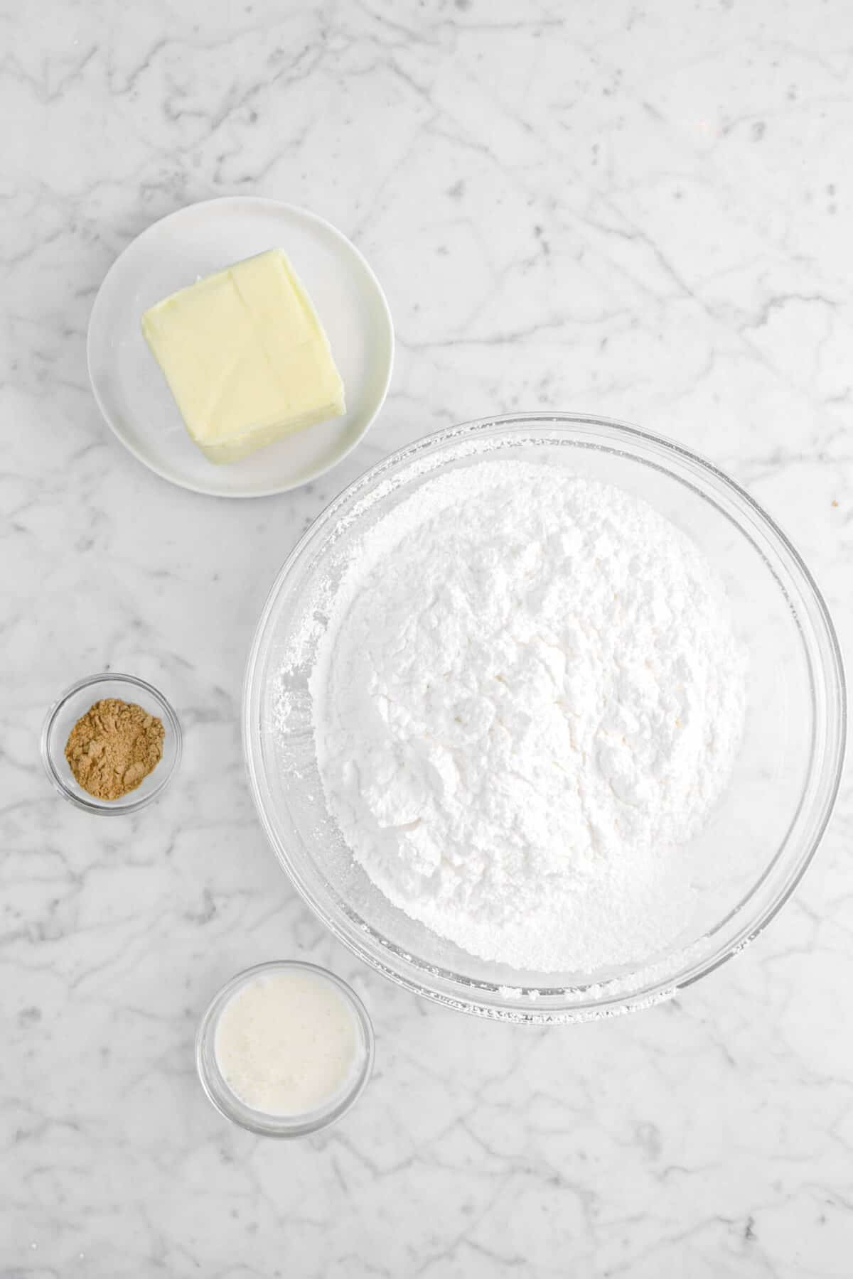 butter, chai spice, cream, powdered sugar in bowls