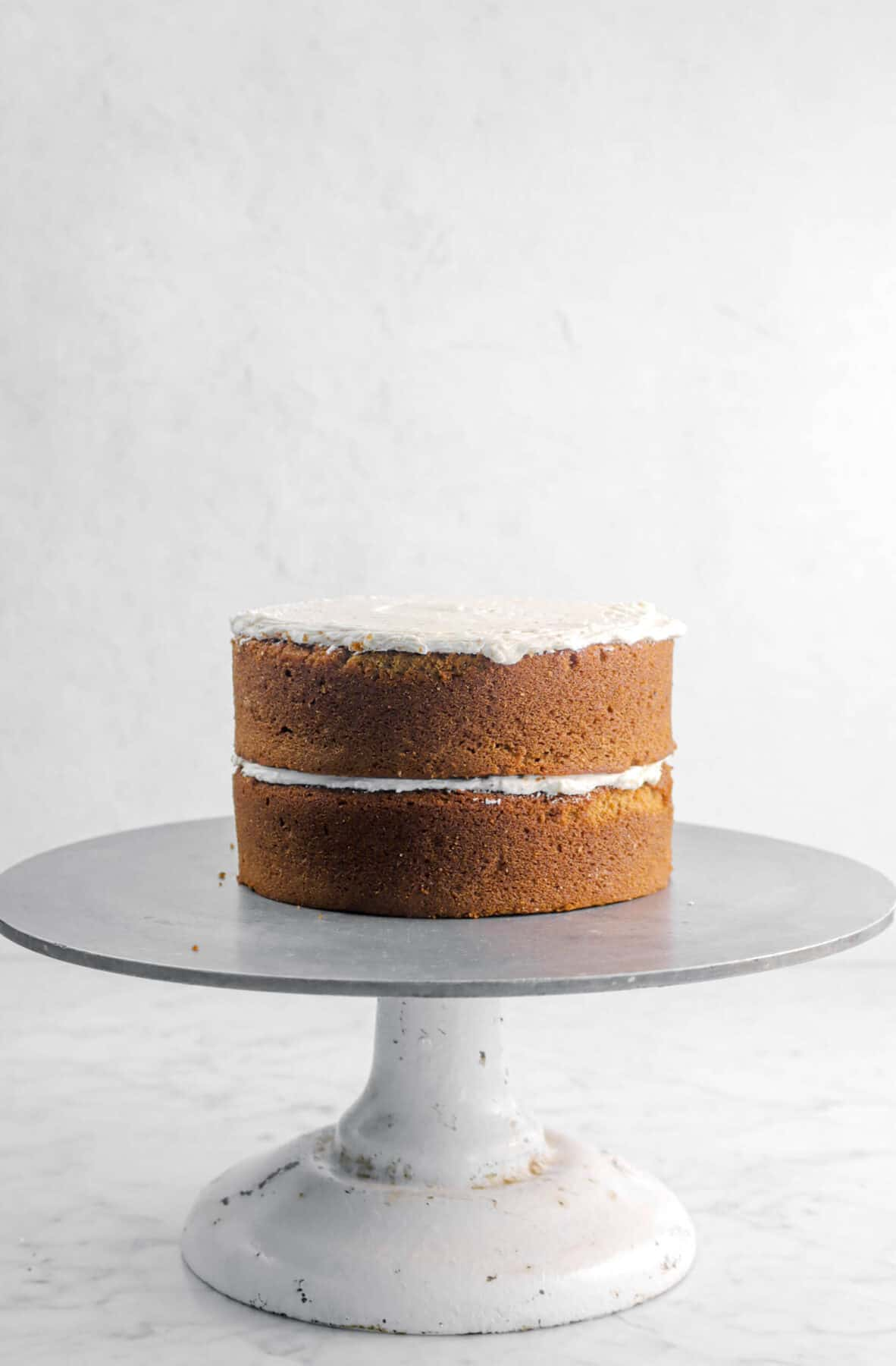frosting on top of cake layer