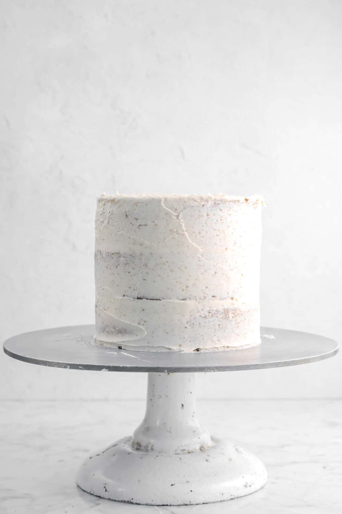 chai frosting spread over cake