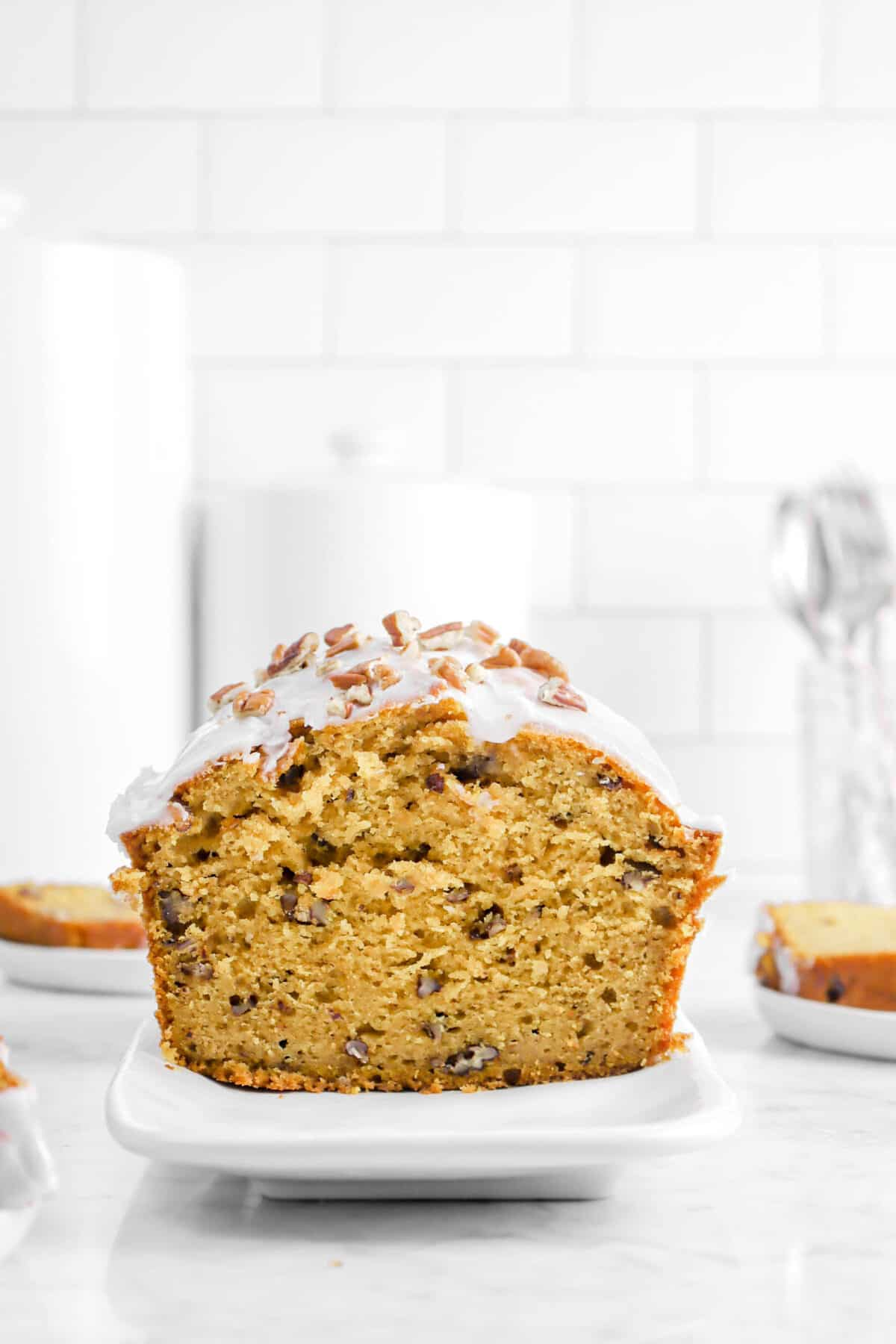 pumpkin bread facing front with two slices behind