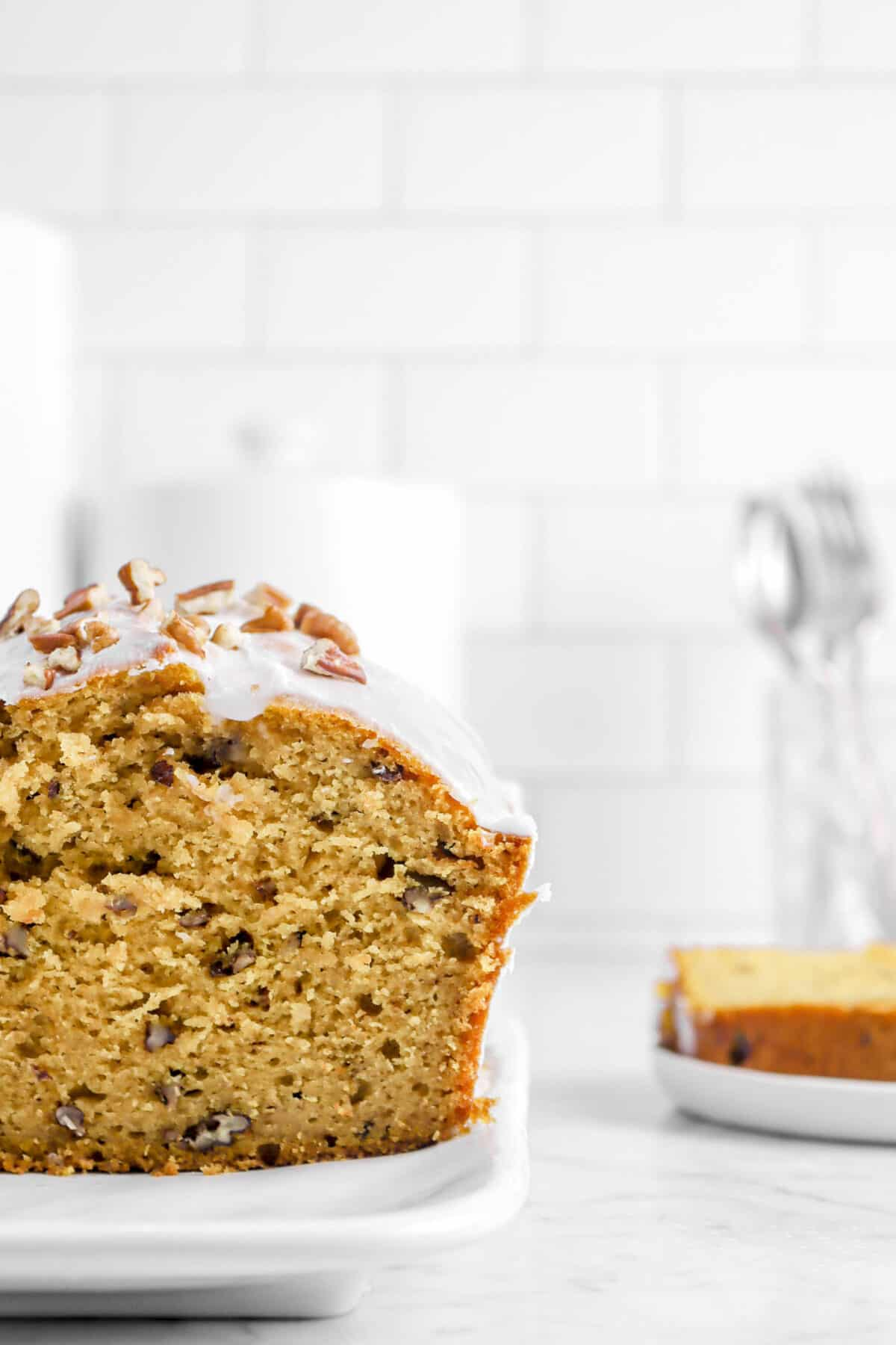 close shot of pumpkin bread with slice behind