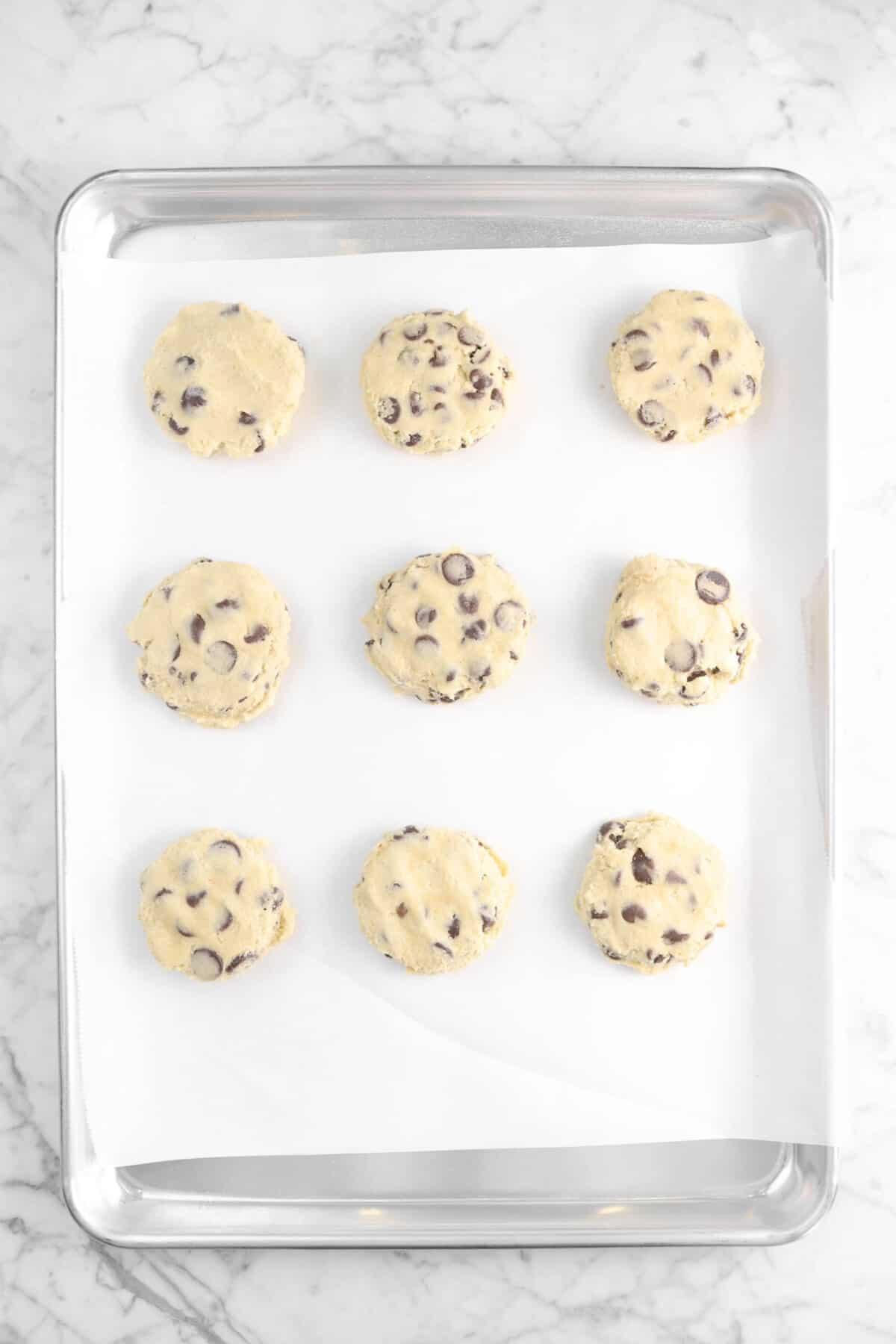 nine cookies on a baking sheet
