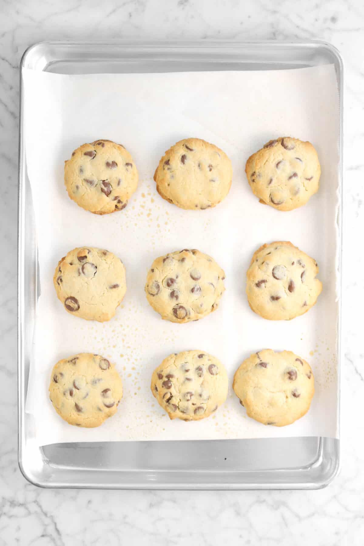 nine baked cookies on a baking sheet