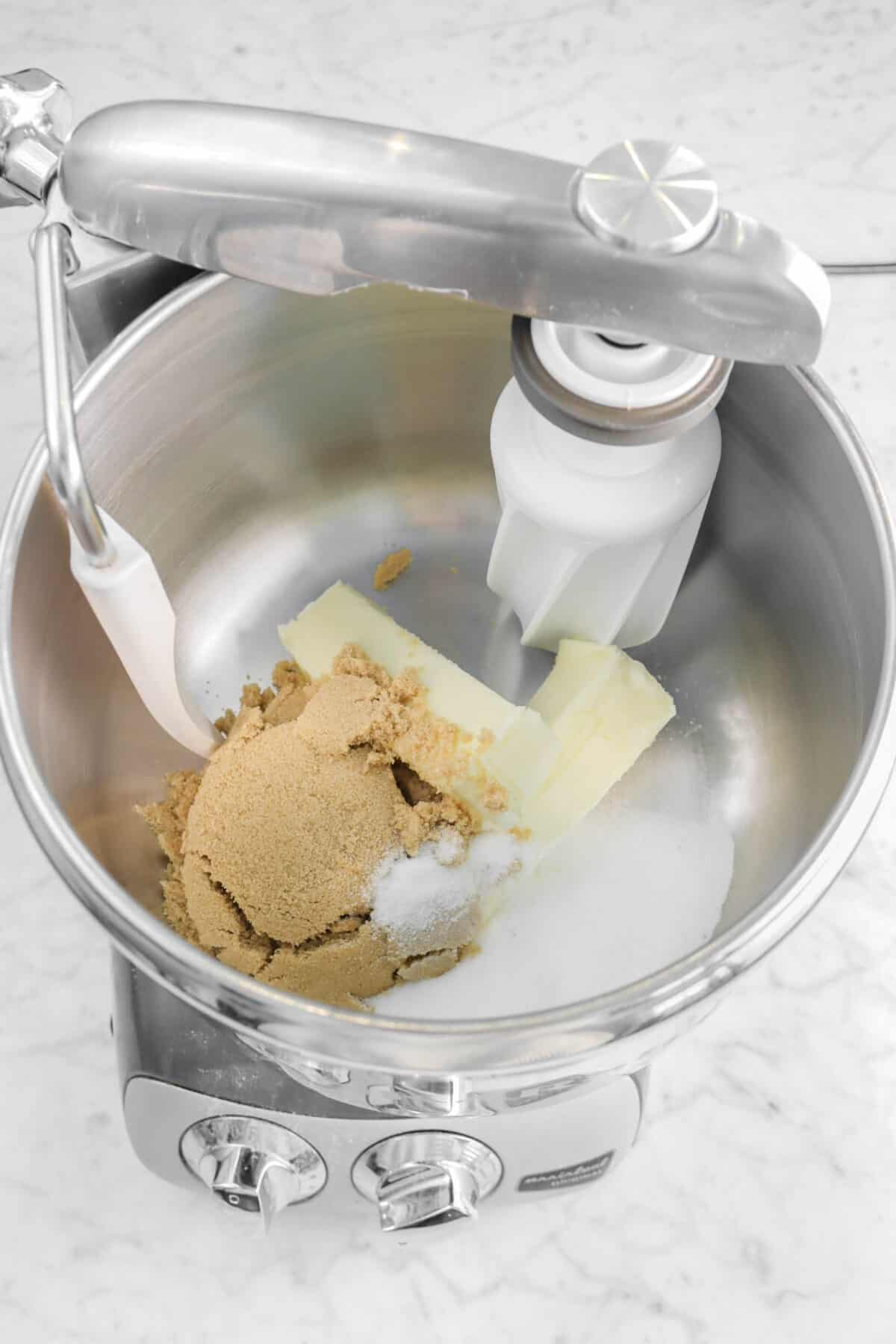 brown sugar, white sugar, and butter in a mixer