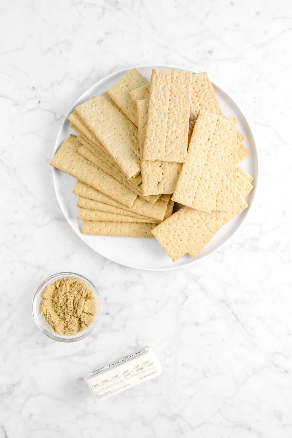 graham crackers, brown sugar, and butter on marble counter