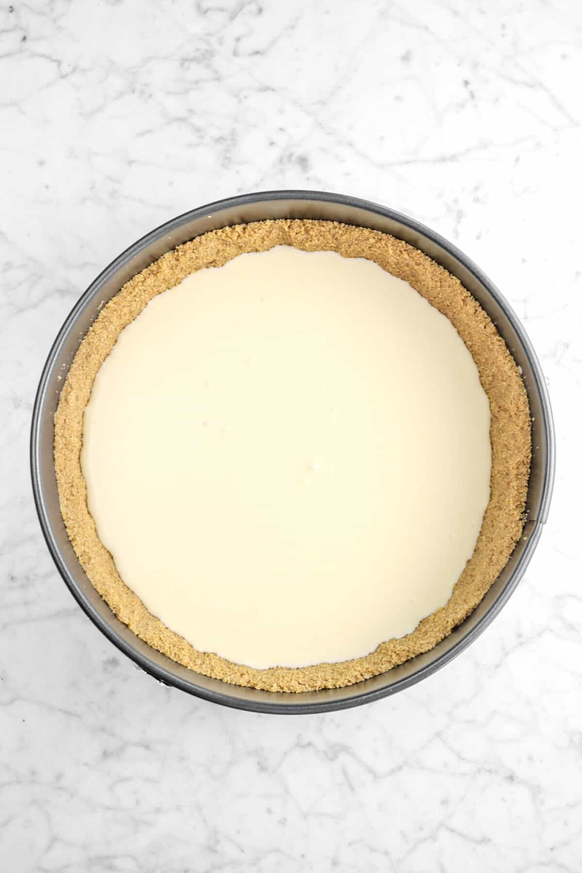 vanilla cheesecake poured into the crust