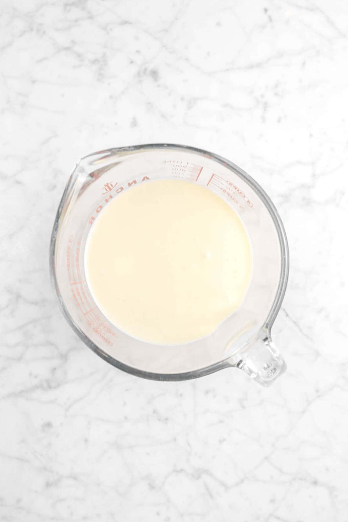 cheesecake batter in a measuring cup