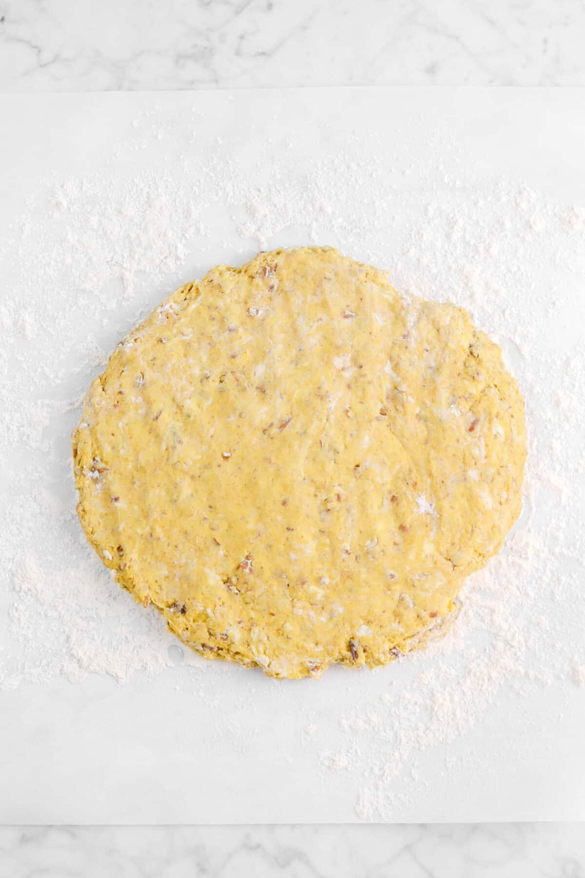 pumpkin scone dough pressed out on parchment