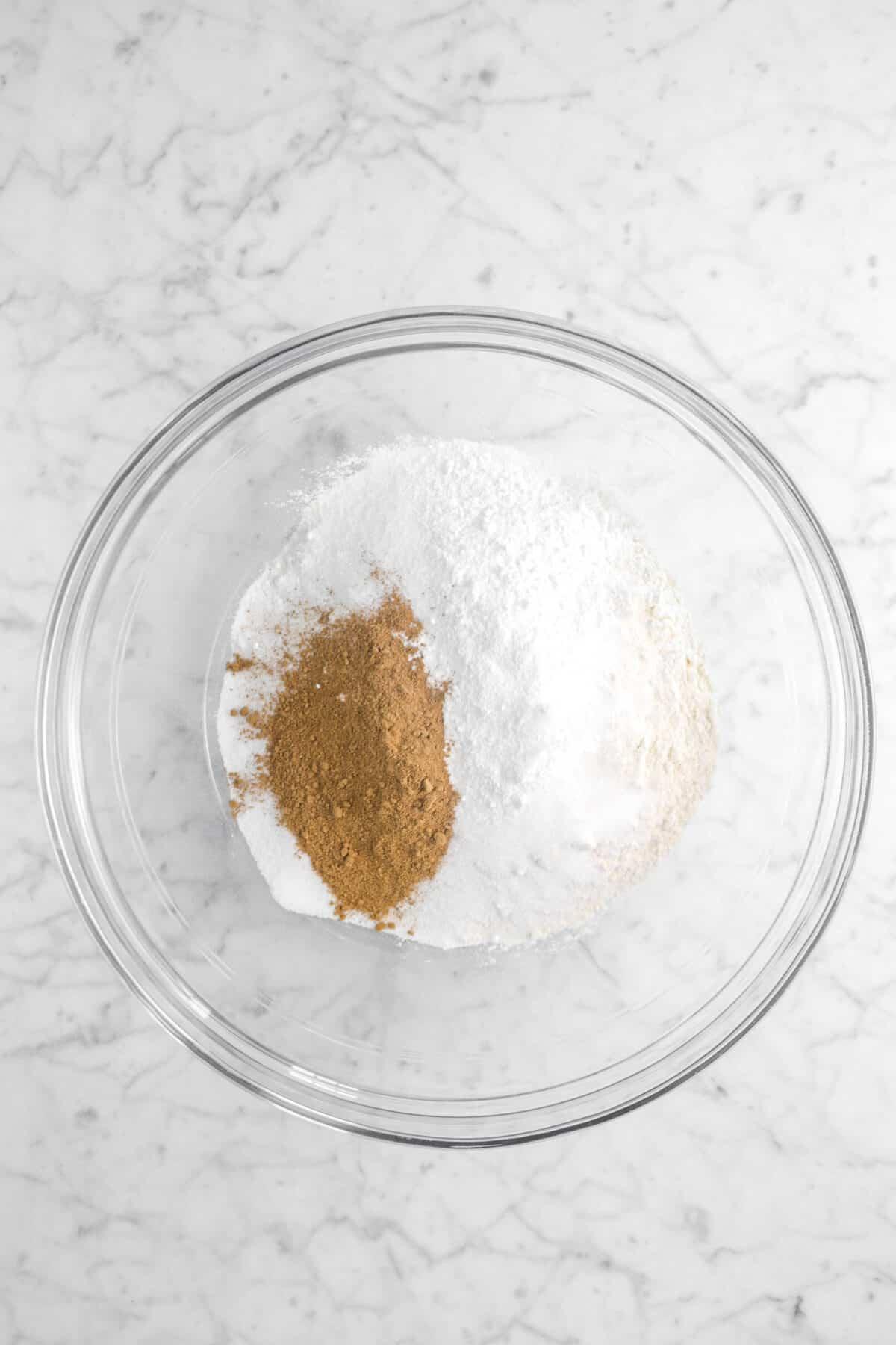 flour, salt, sugar, baking powder, and pumpkin pie spice in glass bowl