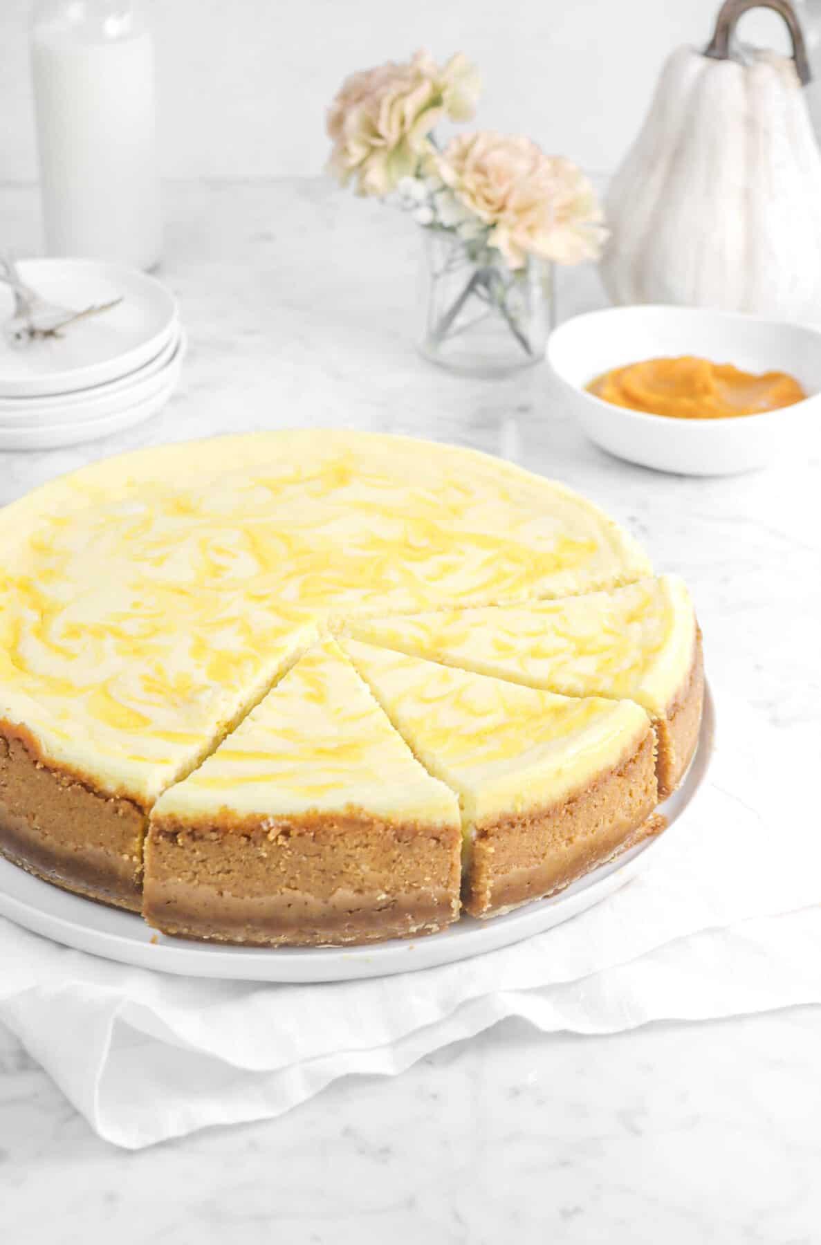 pumpkin swirl cheesecake with three slices