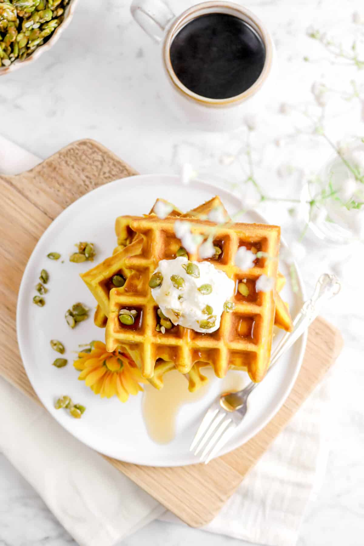 overhead shot of pumpkin waffles on a white plate