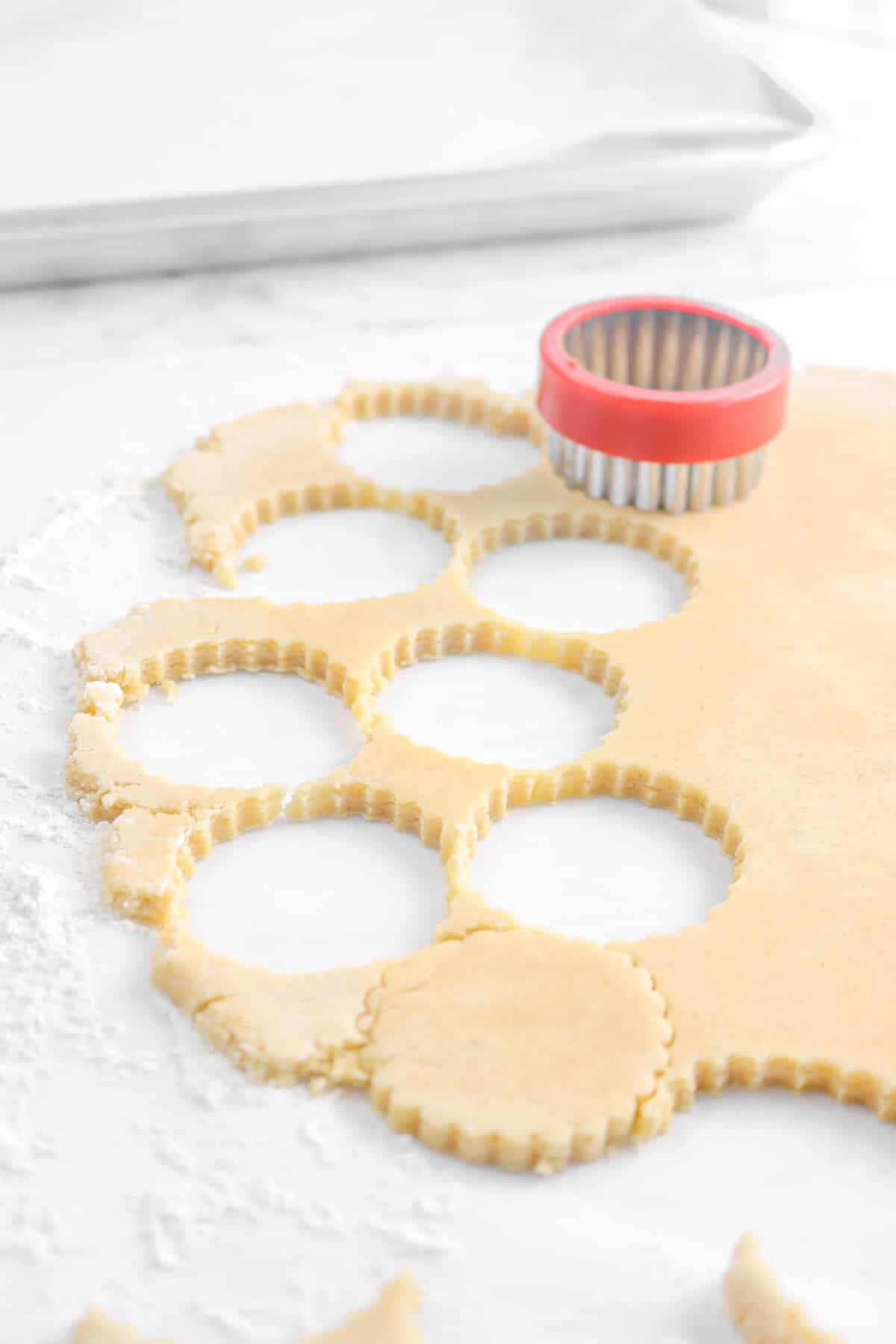 cookies being cut from cookie dough