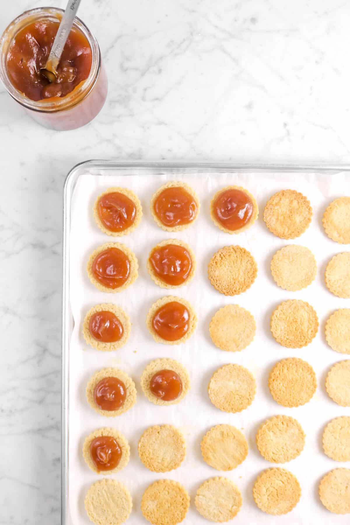 ten cookies with apple butter spooned on top