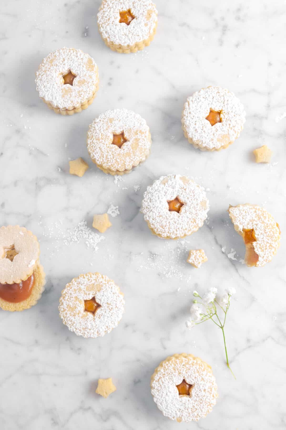 overhead shot of ten apple butter cookies with white flowers