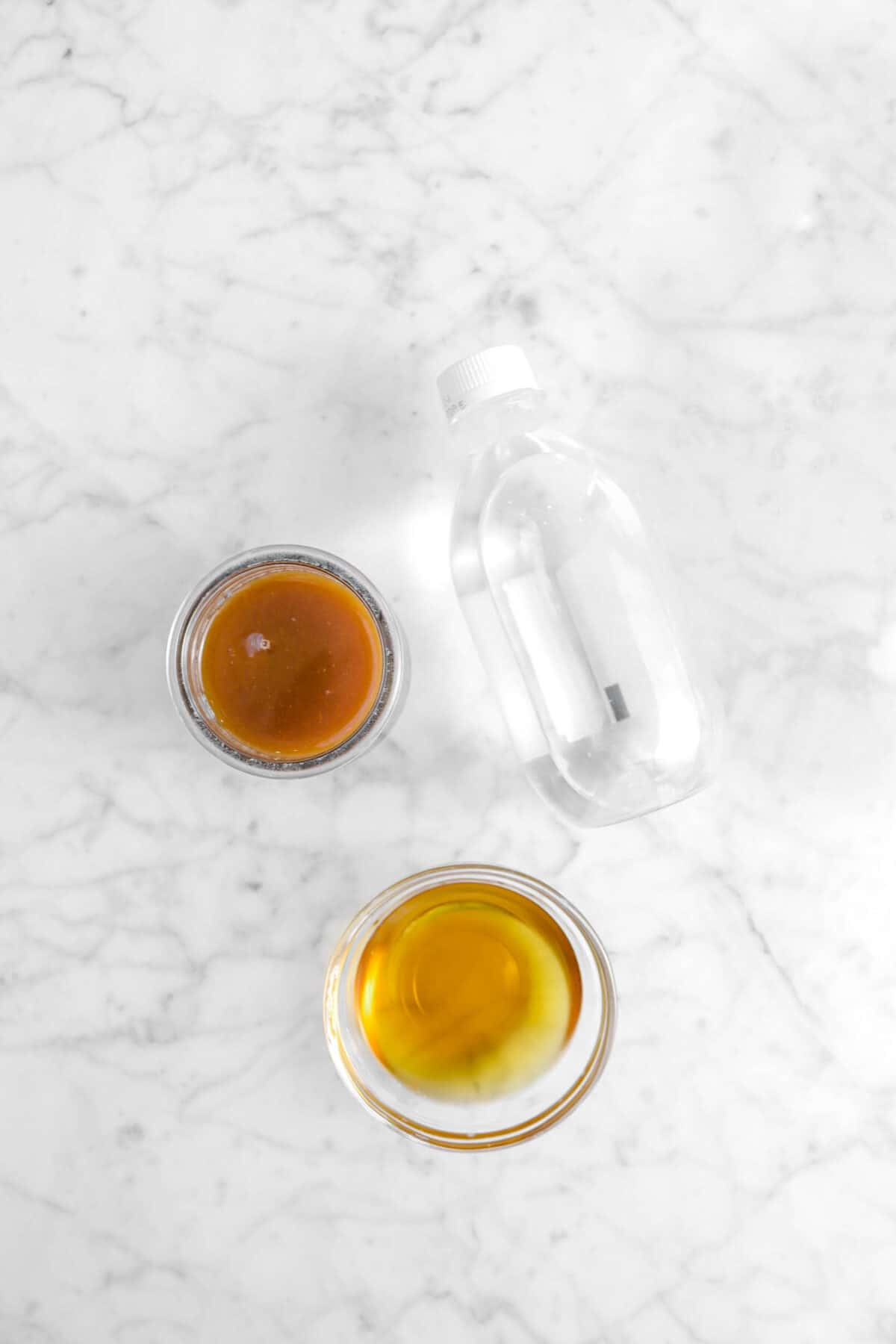 club soda, bourbon, and boiled cider on marble counter