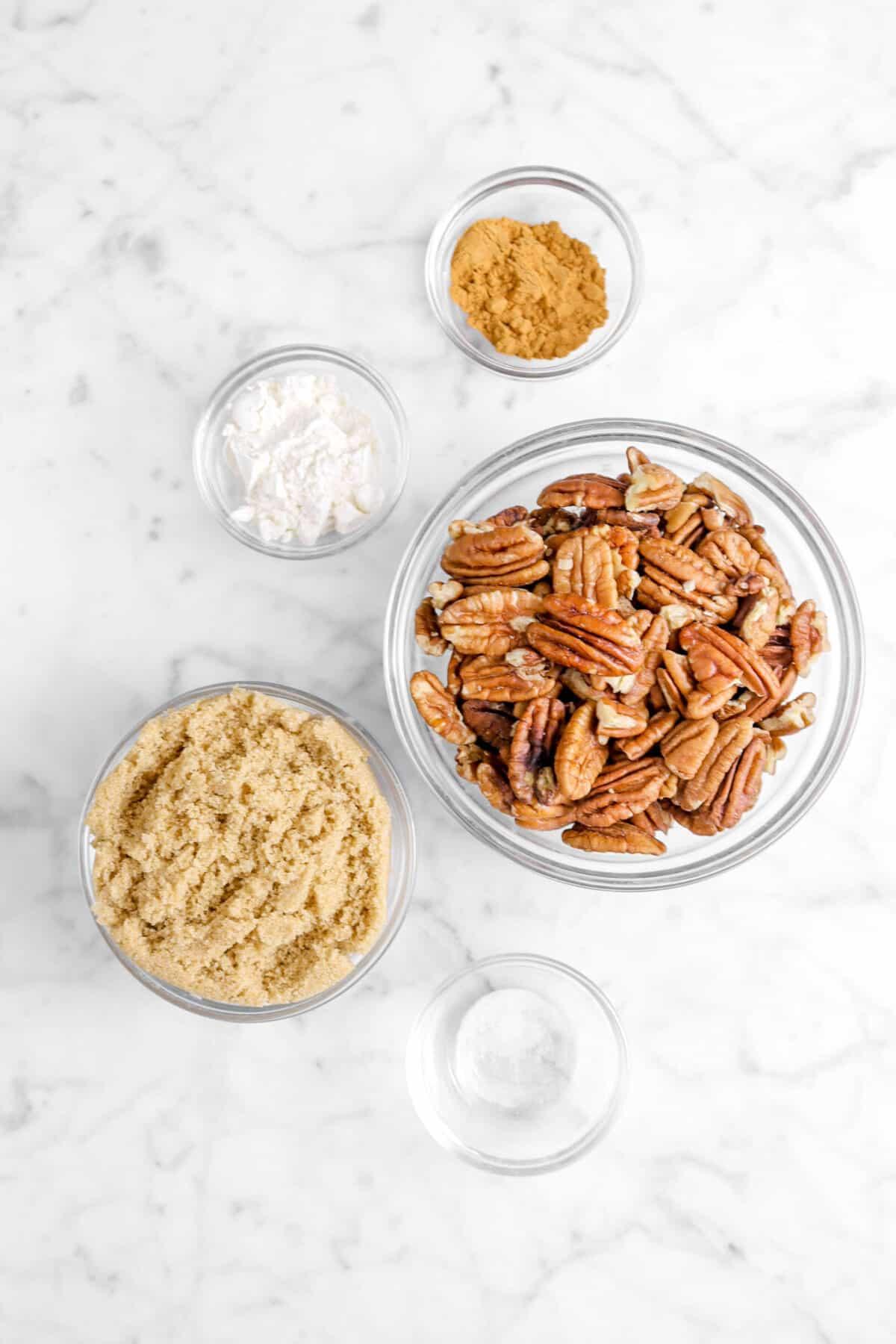 cinnamon, flour, brown sugar, pecans, and salt in glass bowls